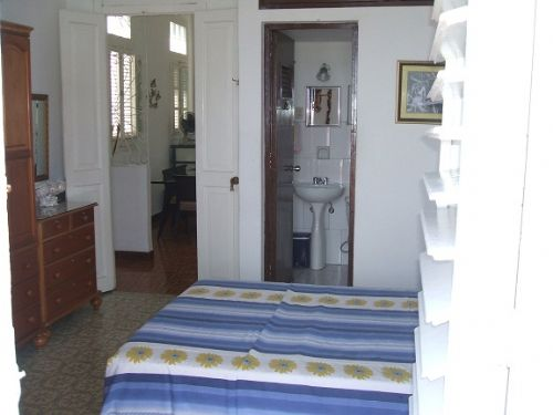 'Bedroom and Bathroom1' is what you can see in this casa particular picture. Casas particulares are an alternative to hotels in Cuba. Check our website cuba-particular.com often for new casas.